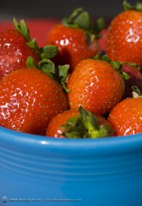 Strawberry still life photograph using complimentary colors