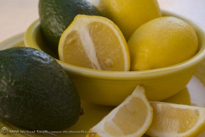 Lemon and avacado still life photograph using analogous colors