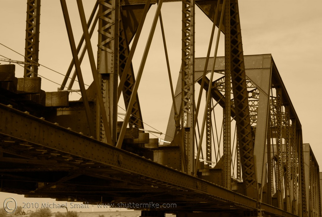Photo of a railroad bridge in a sepia tone