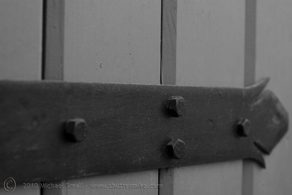 Black and white photo of an antique door hinge