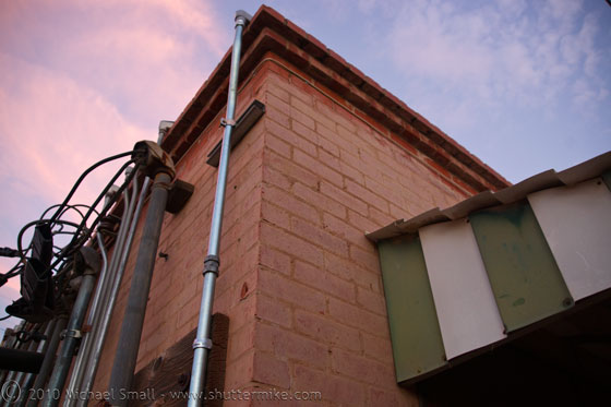 Photo of the corner of a red brick building in Chandler, AZ