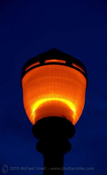 Photo of a lamp post at night