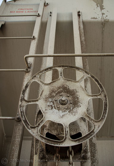 Photo of a sterring wheel on a train car
