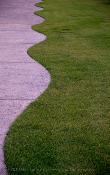 Photo of a curved line made from concrete and grass