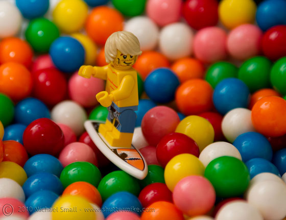 Photo of a surfer Lego mini fig and bubble gum balls