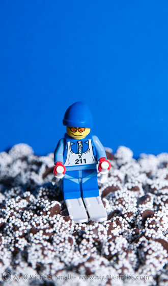 Photo of a Lego mini figure skier and Nestle Snow Cap candies
