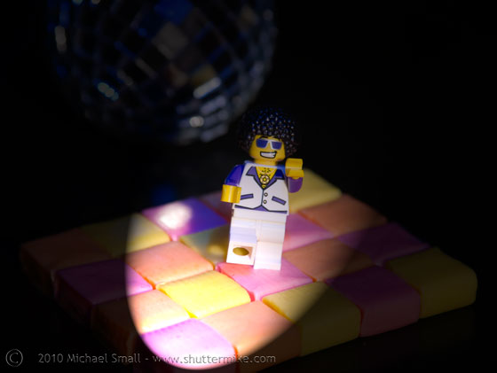 Photo of a Lego disco dancer mini figure with a Starburst candy dance floor.