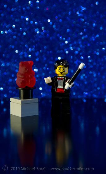 Photo of the magician Lego mini figure with a gummi bear