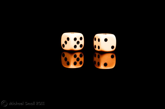 Photo of 2 die against a black background