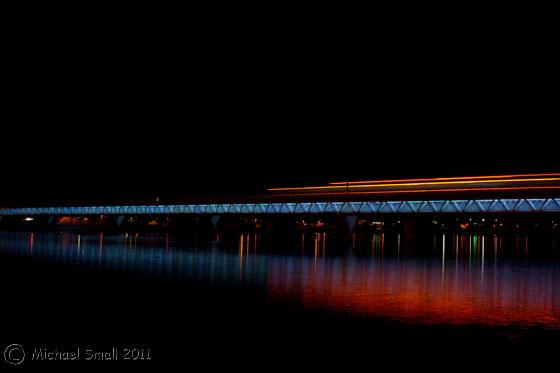 Photo of a train passing over the light rail bridge in Tempe, AZ