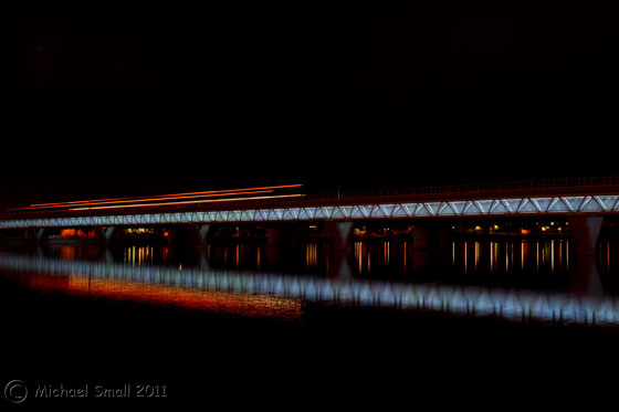 Photo of the light rail train traveling over the bridge in Tempe, AZ
