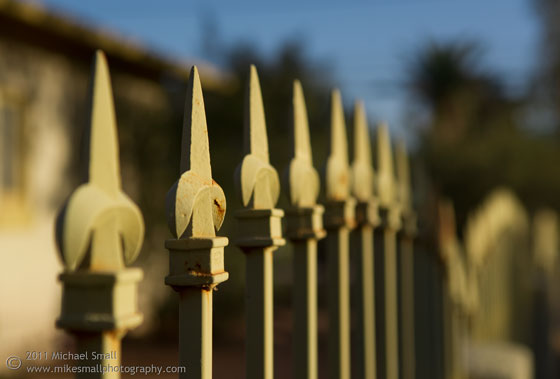 Photo of an iron fence using a very narrow depth of field