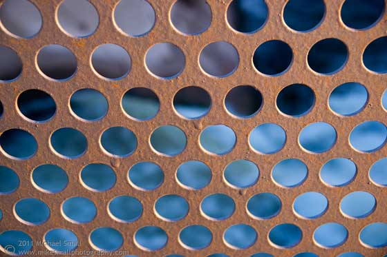 Photo of a metal sheet punched with circles