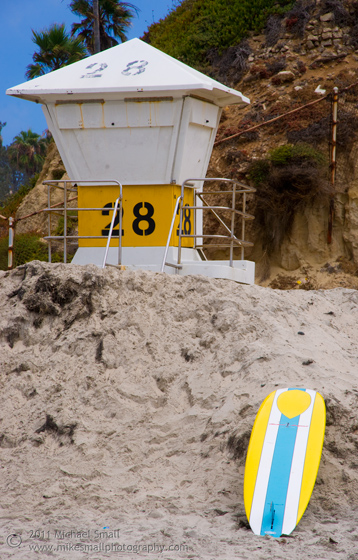 Photograph of a life guard tower and surf board