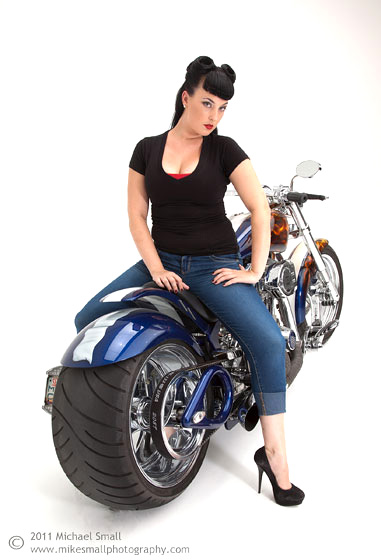Photograph of pin up model and a Steed motorcycle