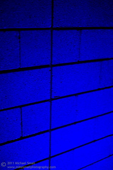 Photo of a blue cinder block wall