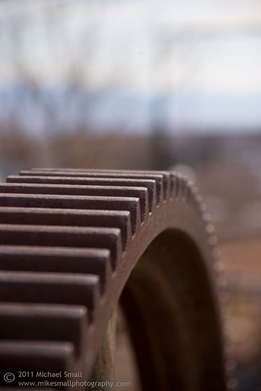 Photograph of a rusted cog with a narrow depth of field