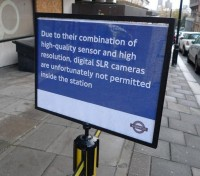 Photo of a sign banning DSLR photography on a London Tube tour