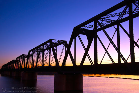 Photgraph of a railroad trestle at twilight