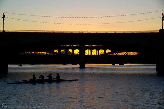 Photo of a rowing crew on Tempe Town Lake at sunset