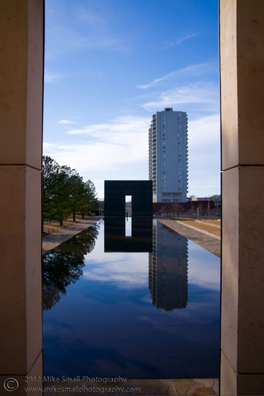 Photo of the reflecting pool of the OKC Memorial seen through the entry gate